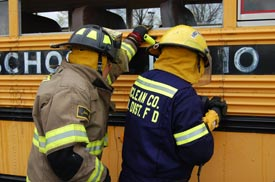 Firefighters train near a schoolbus